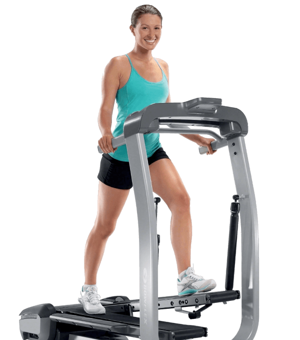 woman practicing at home using an elliptical trainer